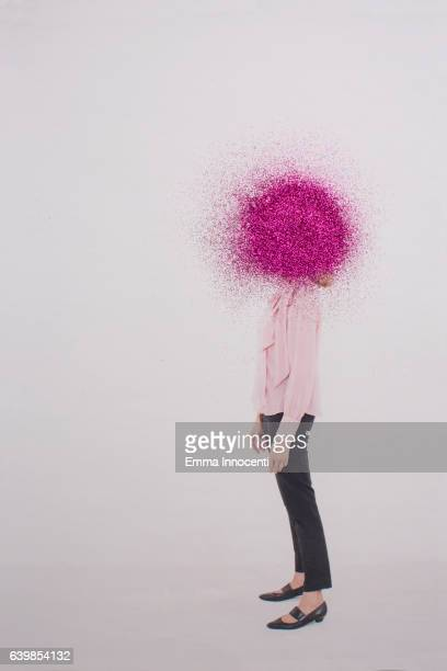 mature woman with head covered by pink ball - obscured face stock pictures, royalty-free photos & images