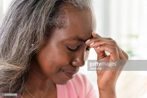 mature woman with headache - medical condition stock pictures, royalty-free photos & images