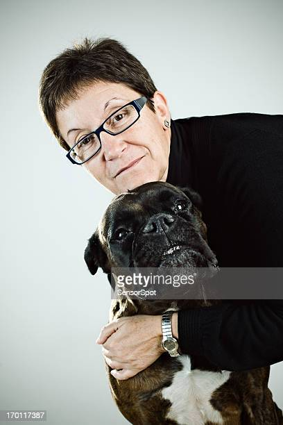 mature woman with her dog - old ugly woman stock photos and pictures