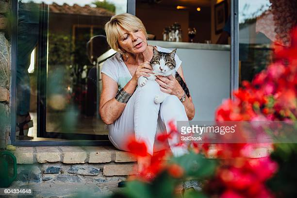 Mature Woman with her Pet Cat
