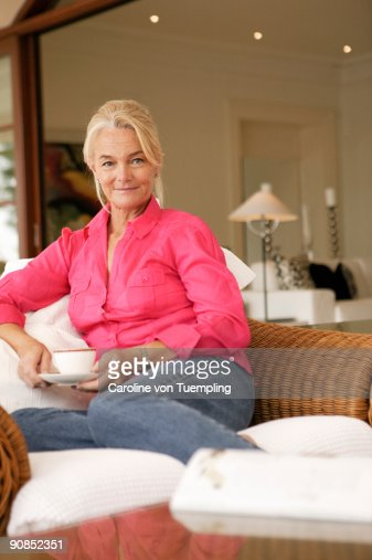 Mature Woman With Hot Drink Smiling To Camera High-Res -7133
