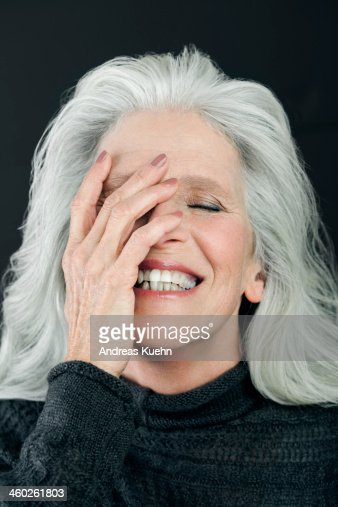 Mature Woman With Long Gray Hair Laughing Stock Photo
