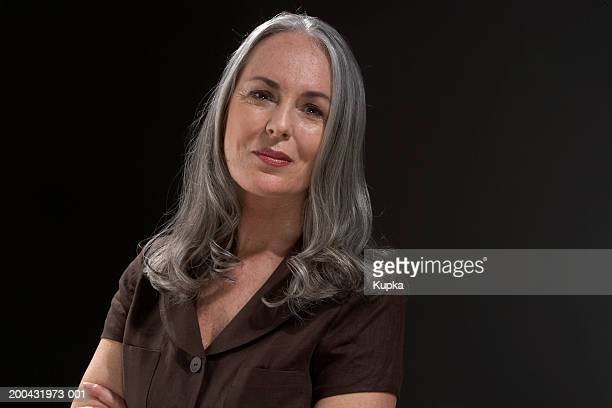 mature woman with long grey hair, portrait - one mature woman only stock pictures, royalty-free photos & images