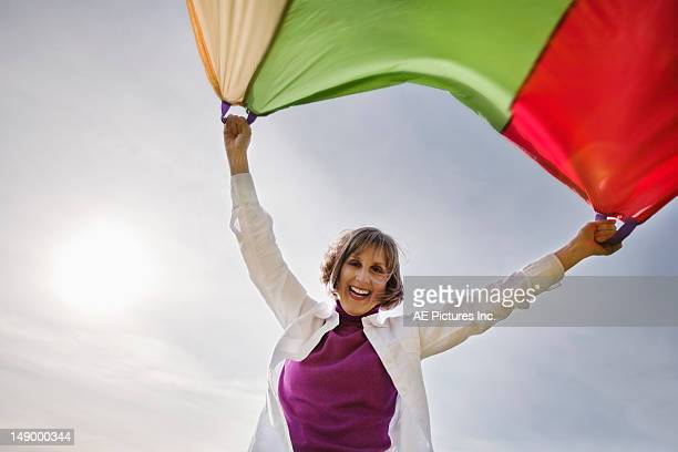 Mature woman with parachute