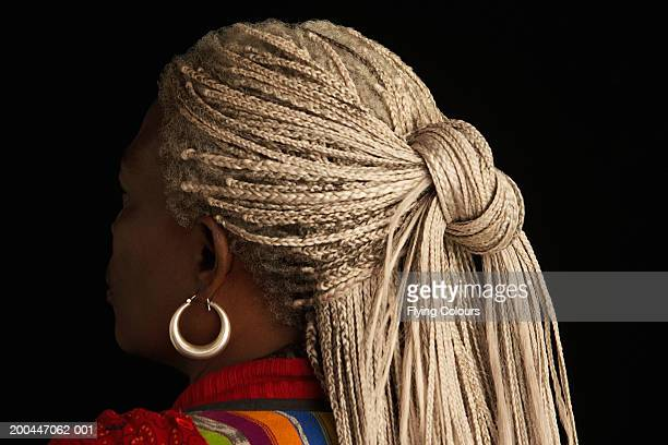 Mature woman with plaits in hair, close-up