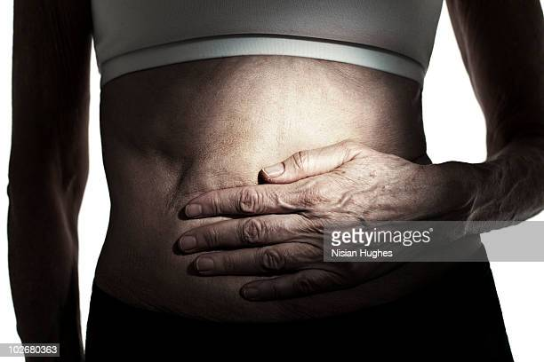 mature woman with stomach ache