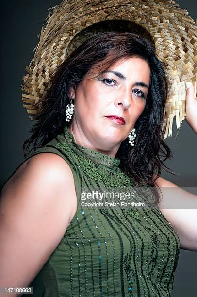 Mature woman with straw hat