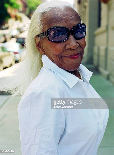 mature woman with sunglasses, portrait - ugly black women stock photos and pictures