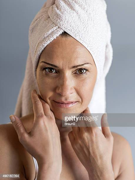 mature woman with towel wrapped around her head. - wearing a towel stock pictures, royalty-free photos & images