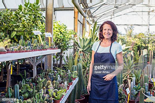 Mature woman working at plant nursery