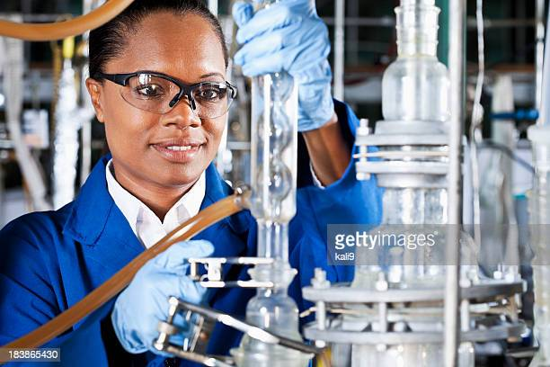 Mature woman working in chemical plant