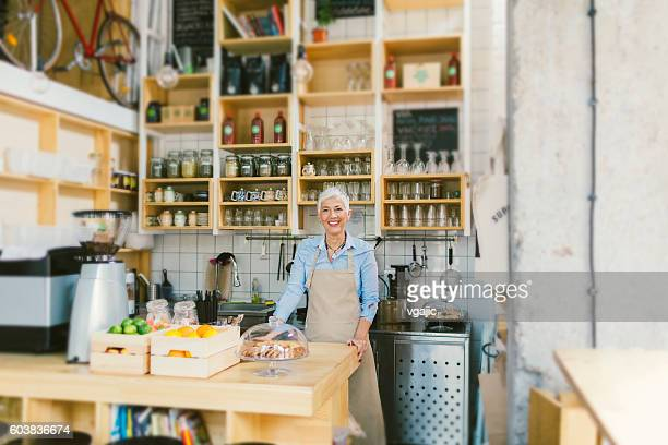 Mature Woman Working In Her Smoothie Cafe
