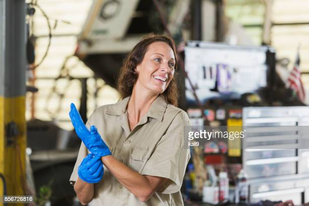 mature woman working in repair shop - stereotypically working class stock pictures, royalty-free photos & images