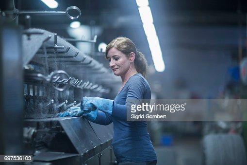 Mature woman working in the steel wool cleaner industry, Lahr, Baden-Wuerttemberg, Germany
