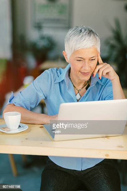Mature Woman Working Out Of Office