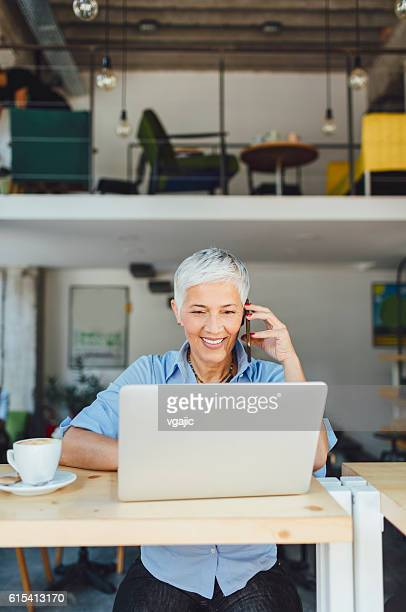 Mature Woman Working Out Of Office.