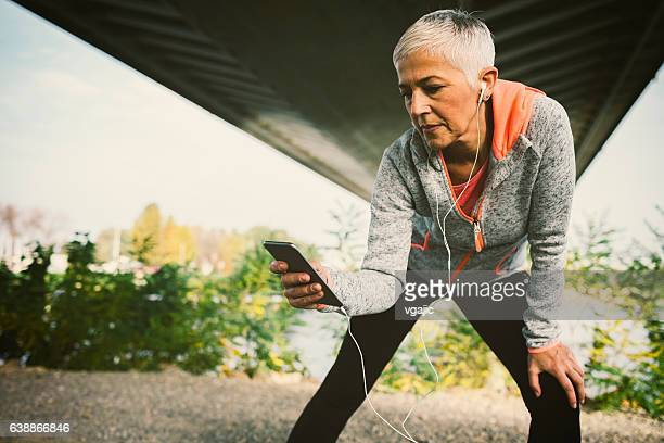mature woman working stretching exercise. - stone age - fotografias e filmes do acervo