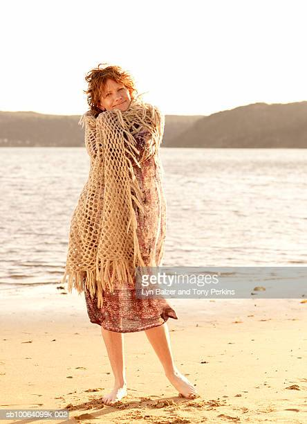 mature woman wrapped in scarf - shawl stock pictures, royalty-free photos & images