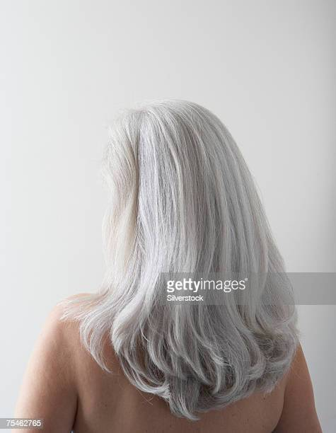 mature woman's head and hair, rear view - graues haar stock-fotos und bilder