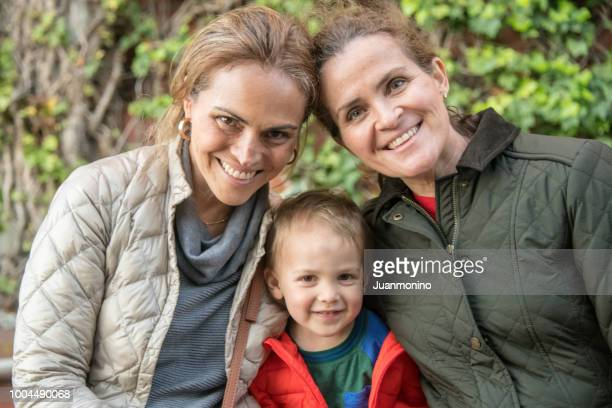 mature women and a toddler posing together - aunt stock pictures, royalty-free photos & images