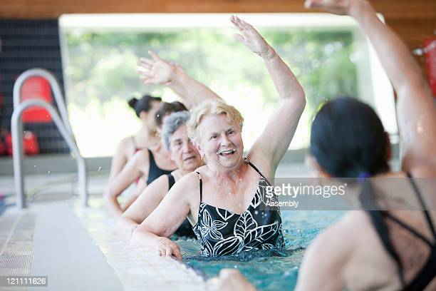 Mature women doing aquacise in pool