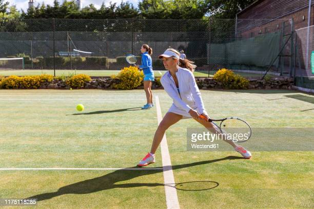 mature women during a tennis match on grass court - pair stock pictures, royalty-free photos & images