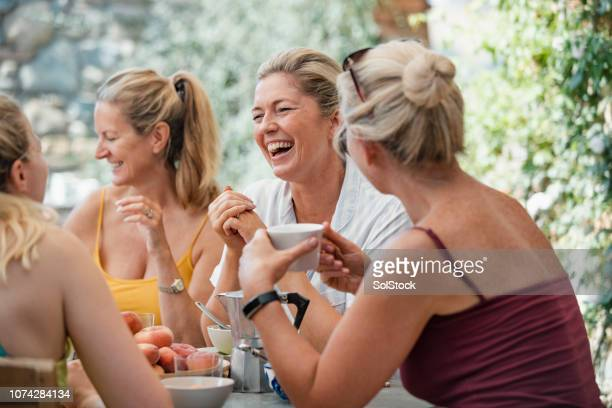 mature women enjoying holiday breakfast - friendship stock pictures, royalty-free photos & images