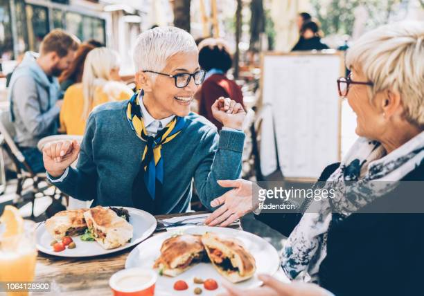 mature women have a lunch - the brunch stock pictures, royalty-free photos & images