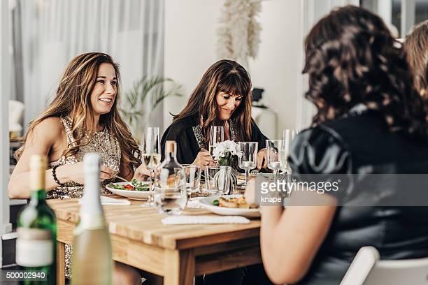 Mature women having dinner party