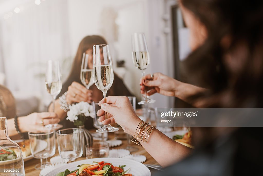 Mature women having dinner party : Stock Photo