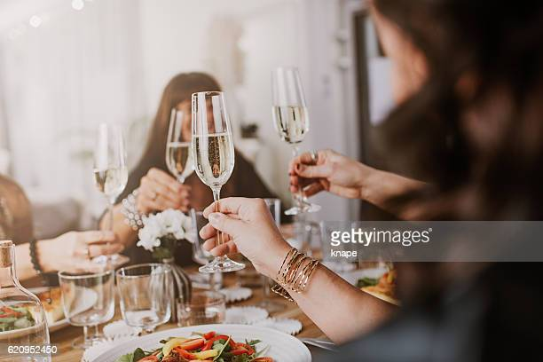 mature women having dinner party - champagne stock pictures, royalty-free photos & images