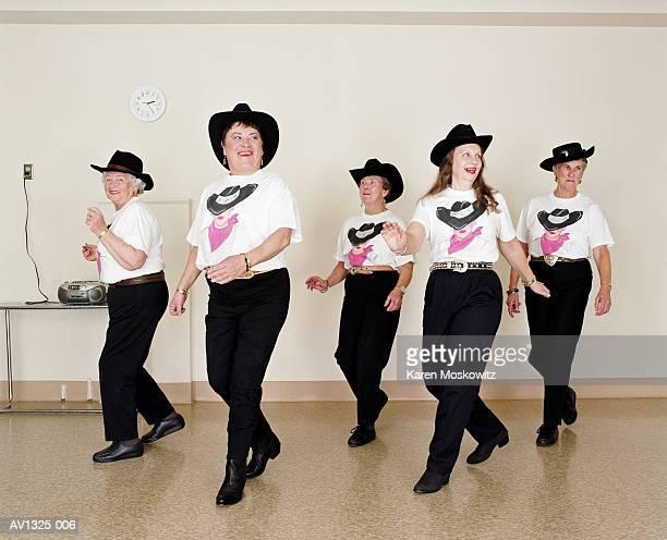 Mature women, line dancing, dance studio