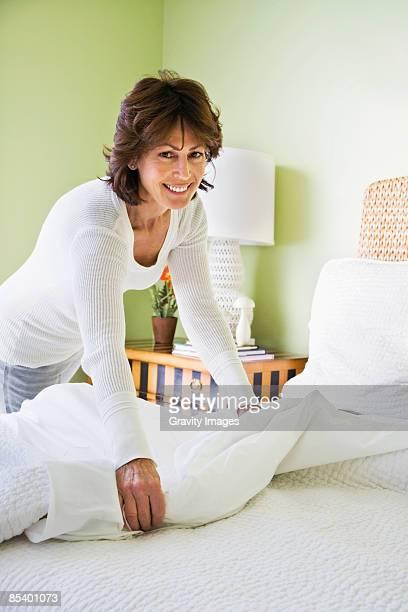 Mature women making bed