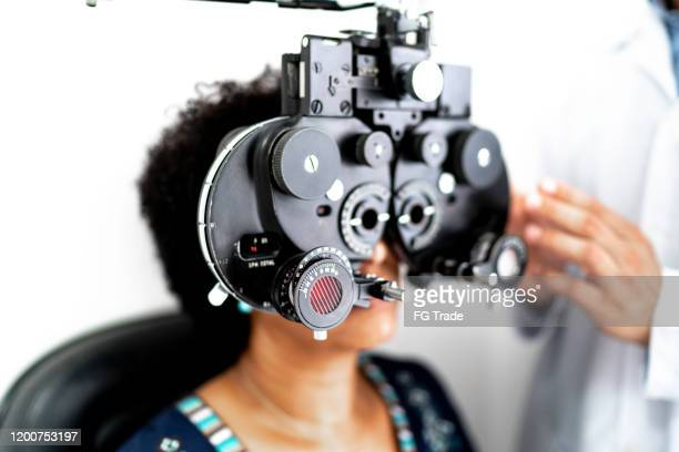 mature women on a medical appointment with ophthalmologist - eyesight stock pictures, royalty-free photos & images