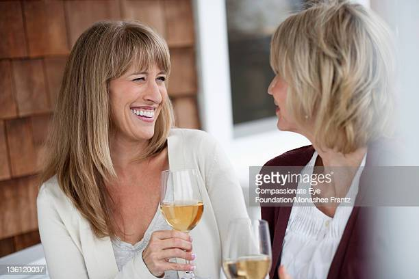 mature women outdoors drinking wine, smiling - cef stock pictures, royalty-free photos & images