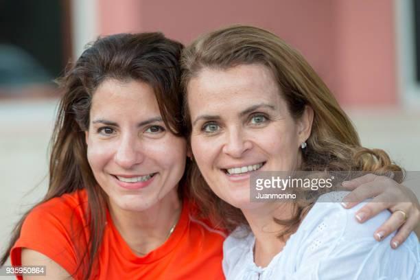 Mature women posing together smiling