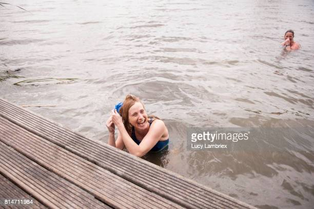 Mature women swimming in open water