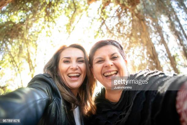 mature women taking a selfie - only mature women stock pictures, royalty-free photos & images