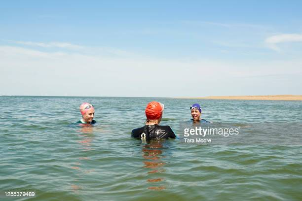 mature women talking in sea - sea swimming stock pictures, royalty-free photos & images