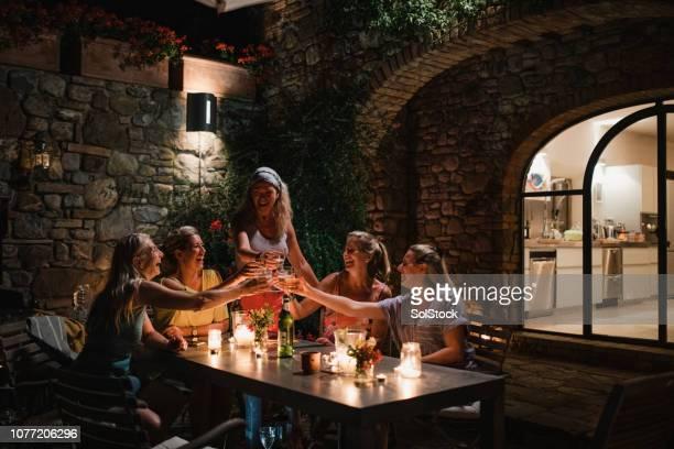 mature women toasting at night - addio al nubilato foto e immagini stock