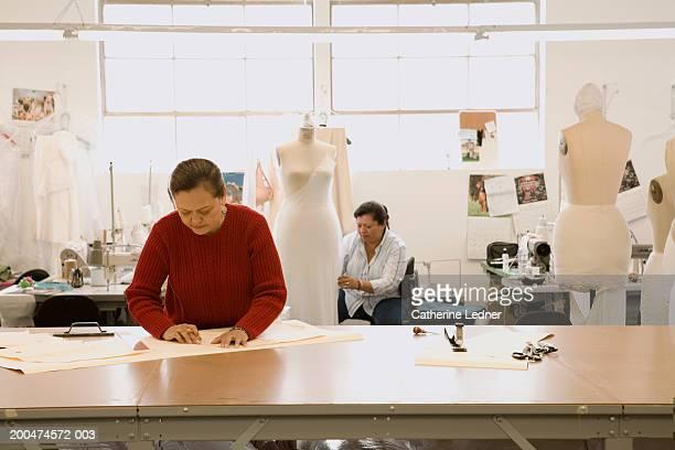 Mature women working in wedding dress factory