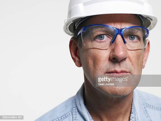 Mature workman wearing goggles, portrait, close-up
