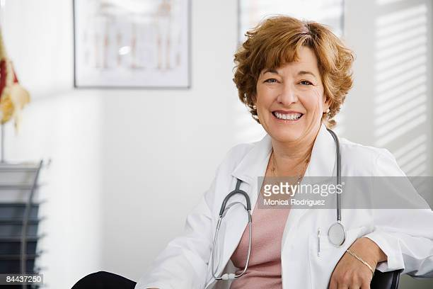 matured female doctor  - female doctor stock photos and pictures