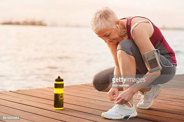 Mature-senior woman jogging beside the sea