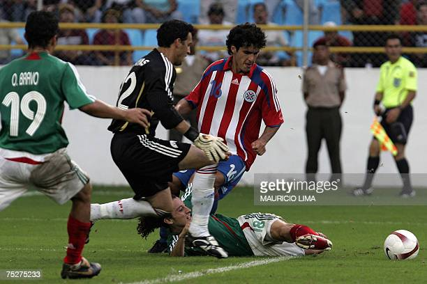 Mexico's Andres Guardado is taclekd by Paraguay's Cristian Riveros what was penalized with a penalty kick by Cuauhtemoc Blanco who scored their fifth...