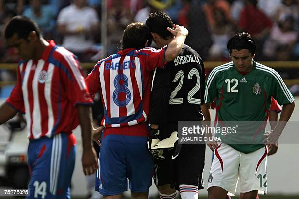 Paraguay's goalkeeper Aldo Bobadilla is conforted by teammate Edgar Barreto after receiving the red card during their Copa America 2007 quarterfinals...