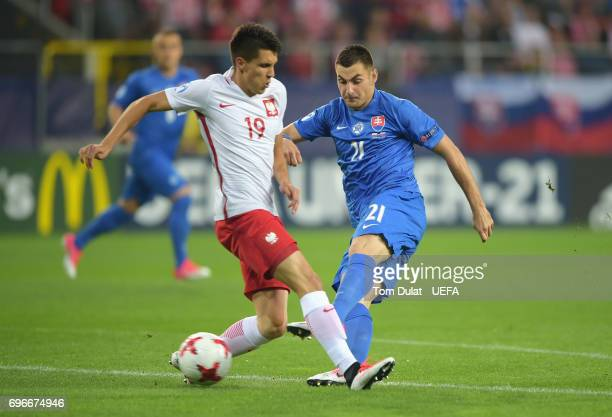 Matus Bero of Slovakia shoots past Bartosz Kapustka of Poland during the UEFA European Under21 Championship match between Poland and Slovakia at...