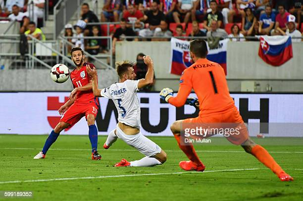 Matus Kozacik of Slovakia makes a save from Adam Lallana of England during the 2018 FIFA World Cup Group F qualifying match between Slovakia and...