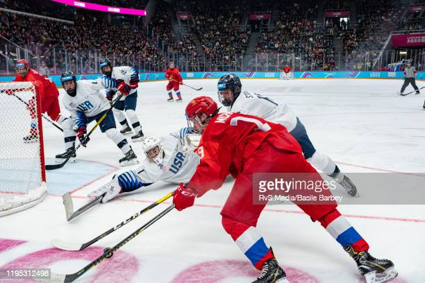 Matvei Michkov battles for the puck with Goalkeeper Dylan Silverstein and Jimmy Snuggerud of United States during Men's 6Team Tournament Gold Medal...