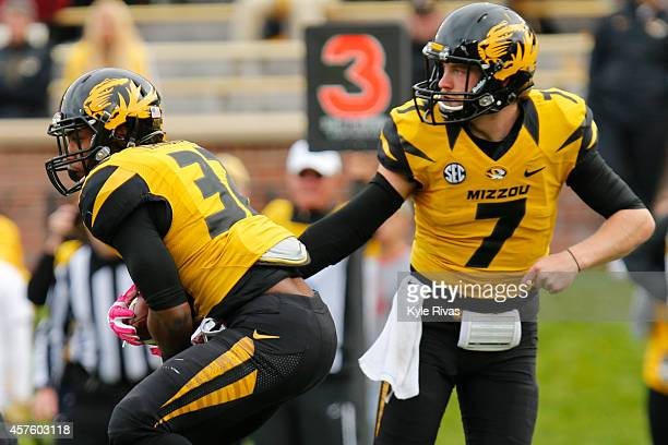 Maty Mauk hands off to Russell Hansbrough of the Missouri Tigers and drives up the field against the Georgia Bulldogs defense in the second half on...